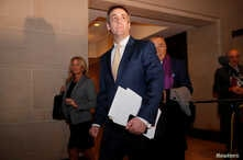 FILE - Michael Cohen, the former personal attorney of U.S. President Donald Trump, arrives to testify before a closed House Intelligence Committee hearing on Capitol Hill in Washington, Feb. 28, 2019.