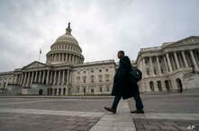 The Capitol is seen as the partial government shutdown lurches into a third week with President Donald Trump standing firm in his border wall funding demands, in Washington, Jan. 7, 2019.