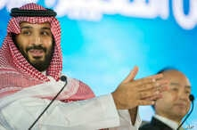 FILE - Saudi Crown Prince Mohammed bin Salman speaks at the opening ceremony of Future Investment Initiative Conference in Riyadh, Saudi Arabia, Oct. 24, 2107. Saudi Arabia's crown prince has promised to return the ultraconservative kingdom to a more