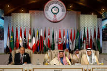 Arab League Secretary-General Ahmed Abul Gheit, Saudi Arabia's King Salman bin Abdulaziz and Saudi Arabia's Foreign Minister Ibrahim al-Assaf attend the 30th Arab Summit in Tunis, March 31, 2019.