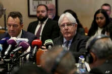 FILE - United Nations Special Envoy to Yemen Martin Griffiths, center, and President of the International Committee of the Red Cross Peter Maurer, participate in a new round of talks by Yemen's warring parties in Amman, Jordan, Feb. 5, 2019.