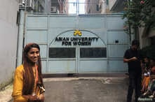 Formin Akter, a Rohingya refugee girl, stands outside the gates of the Asian University for Women on her first day of college in Chittagong, Bangladesh Aug. 26, 2018.
