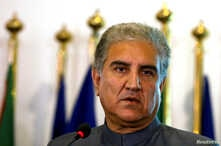 FILE - Pakistan's new Foreign Minister Shah Mehmood Qureshi listens during a news conference at the Foreign Ministry in Islamabad, Pakistan, Aug. 20, 2018.