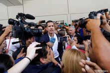 Venezuelan opposition leader Juan Guaido, who many nations have recognized as the country's rightful interim ruler, talks to the media after his arrival at the Simon Bolivar International airport in Caracas, Venezuela March 4, 2019.