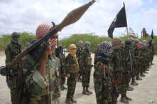 Al-Shabaab fighters display weapons as they conduct military exercises in northern Mogadishu, Somalia, Thursday, Oct. 21, 2010, (AP Photo/Farah Abdi Warsameh)