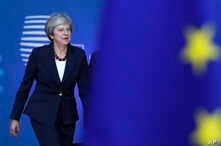 British Prime Minister Theresa May arrives for an EU summit in Brussels,  Oct. 17, 2018.