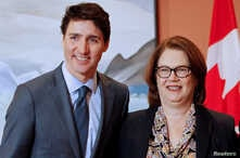 FILE - Newly appointed president of the Treasury Board Jane Philpott poses for a photo with Prime Minister Justin Trudeau during Trudeau's cabinet shuffle, in Ottawa, Ontario, Canada, Jan. 14, 2019.