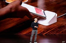 Apple CEO Tim Cook speaks at the Steve Jobs Theater during an event to announce new products, March 25, 2019, in Cupertino, California.