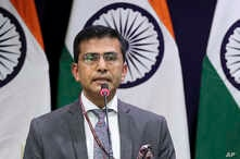 FILE - Indian Foreign Ministry spokesperson Raveesh Kumar delivers a press statement in New Delhi, India, Feb. 27, 2019.