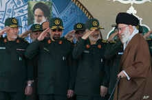 FILE - A picture released by an official website of the office of the Iranian supreme leader, shows Supreme Leader Ayatollah Ali Khamenei (R) arriving at a graduation ceremony of the Revolutionary Guard's officers, as the deputy commander of the Revo