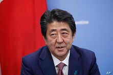 FILE - Japan Prime Minister Shinzo Abe, talks during a meeting with President Donald Trump, Nov. 30, 2018 in Buenos Aires, Argentina.