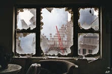 FILE - In this  Sept. 20, 2001 file photo, ground zero is seen through a shattered window of an 18th floor apartment overlooking the World Trade Center site. After the 9/11 attacks, there were grim predictions about the future of the shaken, dust-cov
