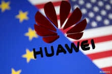 FILE — A 3D printed Huawei logo is placed on glass above a