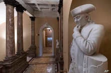 A statue of Benjamin Franklin is seen in an empty corridor outside the Senate at the Capitol in Washington, Dec. 27, 2018, during a partial government shutdown.