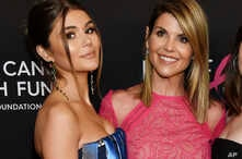 "In this Feb. 28, 2019 file photo, actress Lori Loughlin poses with her daughter Olivia Jade Giannulli, left, at the 2019 ""An Unforgettable Evening"" in Beverly Hills, Calif."