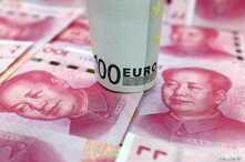 A 100-Euro banknote and Chinese 100-yuan banknotes are seen in this picture illustration, in Beijing, China, January 21, 2016.