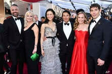 "Evan Hayes, from left, Shannon Dill, Elizabeth Chai Vasarhelyi, Jimmy Chin, Sanni McCandless and Alex Honnold, from the cast and crew of ""Free Solo,"" arrive at the Oscars on Sunday, Feb. 24, 2019, at the Dolby Theatre in Los Angeles."
