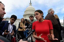FILE - In this Nov. 14, 2018, file photo, Rep.-elect Alexandria Ocasio-Cortez, D-N.Y., talks with reporters following a photo opportunity on Capitol Hill in Washington, with the freshman class.
