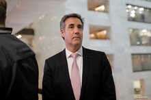 Former Trump personal attorney Michael Cohen departs after testifying behind closed doors before the Senate Intelligence Committee on Capitol Hill in Washington, Feb. 26, 2019.