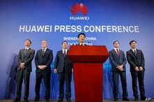 Huawei Rotating Chairman Guo Ping, center, speaks in front of other executives during a press conference in Shenzhen, China's Guangdong province, March 7, 2019.