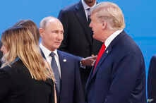 FILE - President Donald Trump, right, walks past Russia's President Vladimir Putin, left, as they gather for a group photo at the start of the G-20 summit in Buenos Aires, Argentina, Nov. 30, 2018.