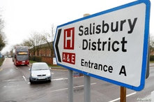 FILE - A sign towards Salisbury District Hospital is seen after Yulia Skripal was discharged, in Salisbury, Britain, April 10, 2018.