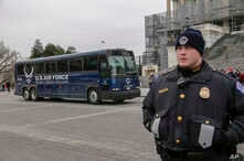 FILE - An Air Force bus waits on the plaza of the Capitol to pick up and transport a congressional delegation. President Donald Trump made such a pickup unnecessary Jan. 17, 2019, when he used his executive power to deny military aircraft to House Sp