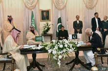 Visiting Saudi Arabia's Crown Prince Mohammed bin Salman, center left, and Pakistani Prime Minister Imran Khan, center right, witness the signing ceremony of the Memorandum of Understanding (MOU) on Petroleum, in Islamabad, Pakistan, Sunday, Feb. 17,...
