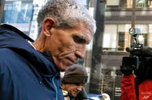 """FILE - William """"Rick"""" Singer founder of the Edge College & Career Network, departs federal court in Boston after pleading guilty to charges in a nationwide college admissions bribery scandal, March 12, 2019."""