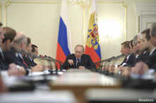 FILE - Russian President Vladimir Putin chairs a Russian government meeting in the Novo-Ogaryovo residence outside Moscow March 5, 2014.