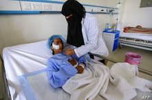 A Yemeni girl injured during a reported airstrike in the Kisar district of the northern Hajjah province receives treatment at a hospital in the Houthi rebel-held capital Sanaa, March 11, 2019.