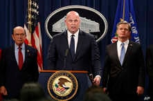 Acting Attorney General Matt Whitaker, center, with Commerce Secretary Wilbur Ross, left, and FBI Director Christopher Wray speak, Jan. 28, 2019, at the Justice Department in Washington.