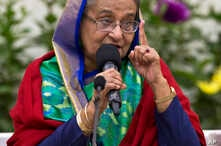 Re-elected Bangladeshi Prime Minister Sheikh Hasina gestures as she speaks with journalists in Dhaka, Bangladesh, Dec. 31, 2018.