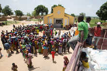 FILE - People queue for food aid distribution delivered by the United Nations Office for the Coordination of Humanitarian Affairs and world food program in the village of Makunzi Wali, Central African Republic, April 27, 2017.