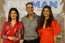 Bollywood actor Akshay Kumar, centre, with his wife Twinkle Khanna left, and Radhika Apte, right, pose for the media during the song launch of their film Pad Man in Mumbai, India, Wednesday, Dec. 20, 2017.