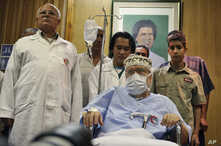 In this Sept. 9, 2009 file photo Libyan Abdel Baset al-Megrahi is seen as he is visited by a group of African parliamentarians, not pictured, at Tripoli Medical Center in Tripoli, Libya.
