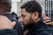 'Empire' actor Jussie Smollett leaves Cook County jail following his release, Feb. 21, 2019, in Chicago.
