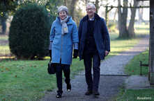 Britain's Prime Minister Theresa May and her husband Philip leave church, near High Wycombe, Britain, Feb. 17, 2019.