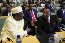 President of Chad Idriss Deby talks to Republic of the Congo President Denis Sassou Nguesso during the High Level Consultation Meetings of Heads of State and Government on the situation in the Democratic Republic of Congo at the African Union Headqua