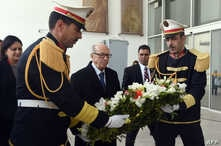 Tunisian President Beji Caid Essebsi, center, lays a wreath at the entrance of the National Bardo Museum in Tunis to pay tribute to the victims of the deadly attack last week claimed by the Islamic State jihadist group, March 22, 2015.
