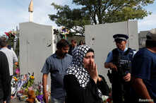 A woman reacts after visiting the reopened Al Noor mosque in Christchurch, New Zealand, March 23, 2019.