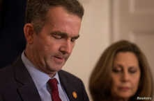 Virginia Governor Ralph Northam, accompanied by his wife Pamela Northam, announces he will not resign, during a news conference in Richmond, Virginia, Feb. 2, 2019.