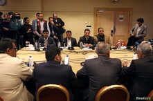 FILE - Yemen's warring parties attend a new round of talks to discuss a prisoners swap deal, in Amman, Jordan, Feb. 5, 2019.