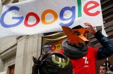 Activists from anti-globalization organisation Attac stage a protest at Google's Paris headquarters to criticize the company's tax evasion policies, in Paris, Jan. 31, 2019.
