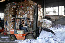 A laborer works at a paper products recycling station in Shanghai, China, Nov. 17, 2017.