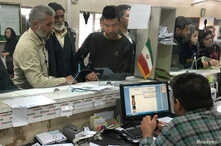 Afghan refugees submit documents at a refugee center in Tehran, Iran, Oct. 24, 2016. Many young men who left Afghanistan for Iran and Pakistan are returning.