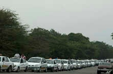 In this Feb. 21, 2019 file photo, taxi cabs line up to fuel up near San Antonio, Venezuela.