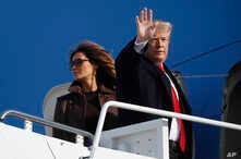 President Donald Trump and first lady Melania Trump board Air Force One, Nov. 29, 2018 at Andrews Air Force Base, Md.