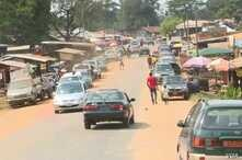 Cars and people move through Ekok, a Cameroonian village on the southwestern border with Nigeria.