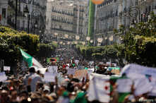 People march to protest against President Abdelaziz Bouteflika's plan to extend his 20-year rule by seeking a fifth term in April elections in Algiers, Algeria, March 1, 2019.